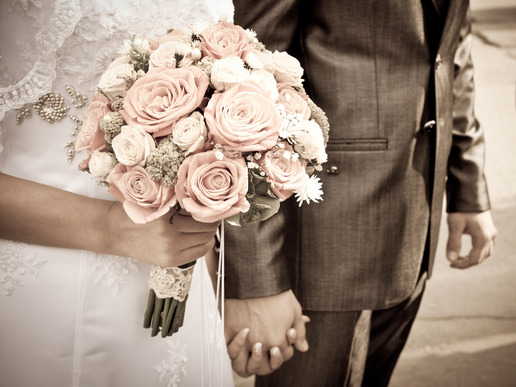 bride holding wedding bouquet and groom